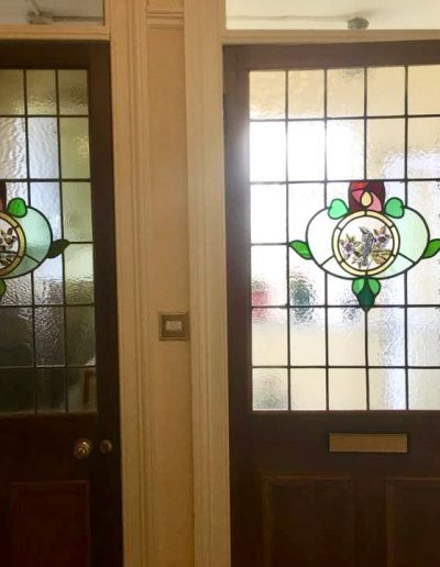 The two door stained glass panels side by side
