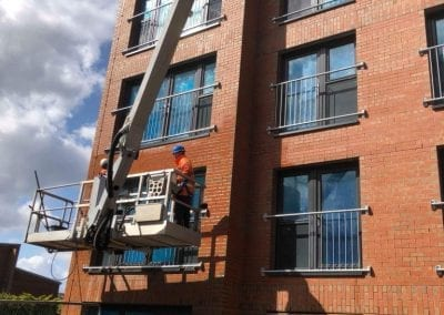 Pressure washing from cherry picker